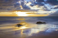 Sunset with Reflection and Dramatic Sky in Maui Hawaii royalty free stock photos