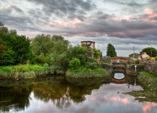 Sunset reflection in HDR. Reflection in the river at sunset - Limerick - Ireland Stock Photo