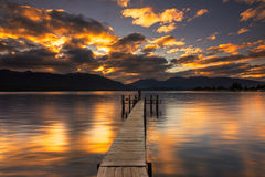 Sunset reflection at a jetty by Lake Te Anau, New Zealand. Stock Image