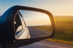 Sunset reflection in the mirror of car. Sunset scene reflection in the mirror of car Stock Photo