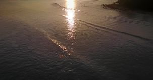 Sunset reflection over the ocean stock video footage