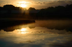 Sunset reflection over a tranquil freshwater lake Royalty Free Stock Image