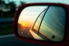 Sunset reflection in the rear view mirror Stock Photos