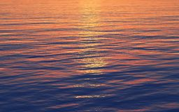Sunset reflection in the sea Stock Photography