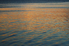 Sunset Reflection on the Surface of a Calm Sea Stock Photography