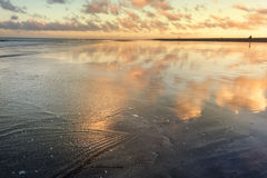Sunset reflection at the time of ebb on Maspalomas beach.Gran Ca Royalty Free Stock Images