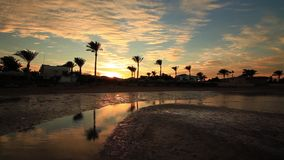 Sunset reflection in the water on the beach. Egypt stock video footage