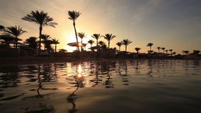 Sunset reflection in the water on the beach. Egypt stock footage