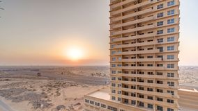 Sunset in Ajman from rooftop timelapse. Ajman is the capital of the emirate of Ajman in the United Arab Emirates. Sunset with reflection in water of Gulf in royalty free stock photos