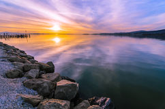Sunset reflection in the waters of the Trasimeno lake, Umbria, I Royalty Free Stock Image