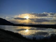 Sunset reflection in winter at Great Salt Lake, by the historic Saltair building, Panorama. The SaltAir, Saltair Resort, or Saltai Stock Photography
