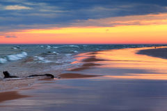 Sunset Reflections on Beach Royalty Free Stock Photography