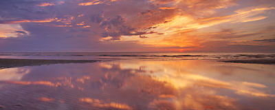 Sunset reflections on the beach, Texel island, The Netherlands Royalty Free Stock Images