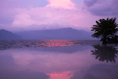 Sunset with reflections, Lake Toba. Royalty Free Stock Images
