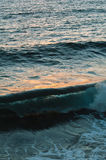 Sunset reflections on the ocean surface with a splashes Royalty Free Stock Image