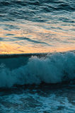 Sunset reflections on the ocean surface Royalty Free Stock Photo