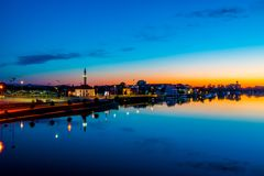 Sunset reflections over city and river stock image