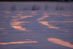 Sunset reflections in snow Royalty Free Stock Photos