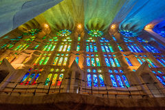 Sunset reflections on the stained glass of La Sagrada Familia church, Barcelona royalty free stock image