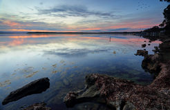 Sunset reflections on the waters of St Georges Basin Royalty Free Stock Image