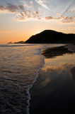Sunset Reflexion in the Ocean. Sunset at the Baleia Beach in Brazil, with golden reflexion from the sun in the ocean Stock Images