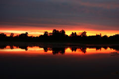 Sunset with reflexion. Stock Image