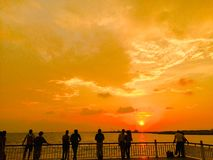 Sunset with relax people stock images