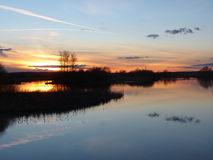 Sunset at Resevoir. Sunset at Abberton Nature reserve Reservoir and reflection on still water Royalty Free Stock Images