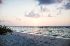 Sunset at a resort on a beach in the maldives islands royalty free stock photos