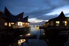 Sunset Resort Near Bay on Mabul Island. View of a chalet resort with bay and boats on Mabul Island, Malaysia Royalty Free Stock Photo