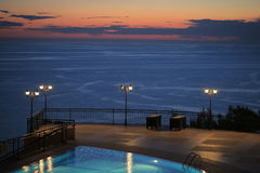 Outdoor swimming pool at sunset Stock Photo