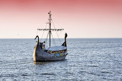 Sunset with retro ship. Stock Images
