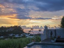 Sunset on reunion island. This is a sunset at the swimming pool, at reunion island , water, tourism, sun, sea Royalty Free Stock Images