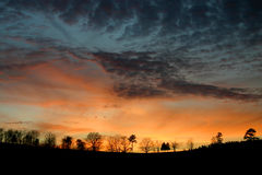 Sunset Ridge. Sunset color with silhoutted ridge and trees. Tenn royalty free stock photos