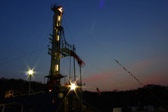 Sunset rig. Dark, sunset a oil rig Royalty Free Stock Image