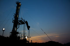 Sunset and rig. Rig and the sun is coming up Stock Image