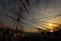 Sunset through the rigging of an  sailing ship Stock Photography