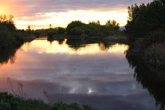 Sunset ripples on the pond Royalty Free Stock Photo