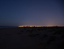 Sunset and the rising of the moon on the Mediterranean coast in southern Spain. Stock Images