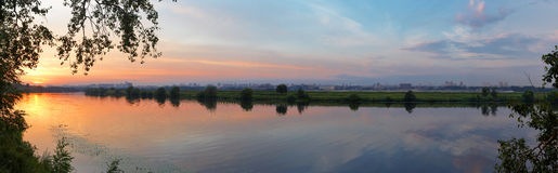 Sunset on the river. With urbanized back royalty free stock images