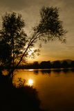 Sunset river. Sunset on the river in autumn sunset Royalty Free Stock Photos