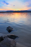 Sunset at river Stock Images