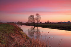 Sunset on the river. In spring Royalty Free Stock Photo