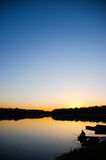 Sunset by the river Stock Photo