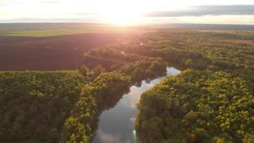 River aerial landscape cinematic drone footage at sunset time. Flying above Dniestr river in Ukraine or Moldova with. Sunset river aerial landscape cinematic stock footage
