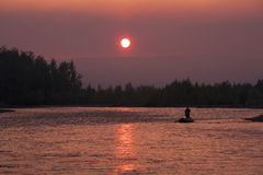 Sunset on the river Ayan- Yuryakh. Magadan region. Russia Royalty Free Stock Photo