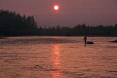 Sunset on the river Ayan- Yuryakh. Magadan region. Russia Royalty Free Stock Images