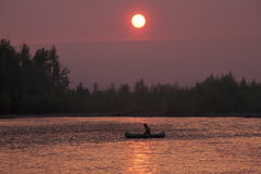 Sunset on the river Ayan- Yuryakh. Magadan region. Russia Stock Images
