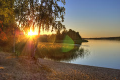 Sunset on river. Beautiful sunset on the banks of the river Vuoksi at quiet summer evening Royalty Free Stock Photos