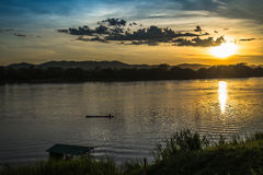 Sunset river beautiful evening. Beautiful Sunset Landscape with reflection on River Sky and Clouds Royalty Free Stock Photo